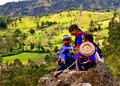 Guambiano children on rock, Colombia Royalty Free Stock Images