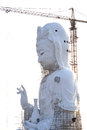 The guan yin goddess giant statue under twilight sky of compassion and mercy yim constructed in thai temple Stock Image