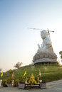 The guan yin goddess giant statue under twilight sky of compassion and mercy yim constructed in thai temple Stock Photos