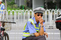 Guangzhou policeman on street china apr a works along the in april Royalty Free Stock Photos