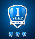 Guarantee label shield on blue background Royalty Free Stock Photos