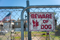 Guard dog sign on a gate Stock Photography