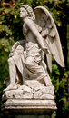 Guardian Angel statue in a cemetery outdoor Royalty Free Stock Photo