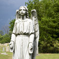 Guardian angel statue in graveyard. Royalty Free Stock Images