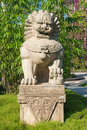 Guardian lion stone statue on pedestal in a park singapore june created by wang rong hai from china xiamen singapore the gardens Stock Images