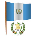 Guatemala wavy flag and coat of arms against white background vector art illustration image contains transparency Stock Image
