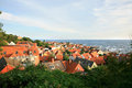 Gudhjem bornholm denmark panorama of picturesque small town with red roofs by early morning Royalty Free Stock Photography