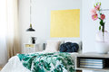 Guest bedroom with yellow artwork Royalty Free Stock Photo