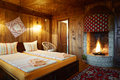 Guest house bedroom with fireplace Royalty Free Stock Photo