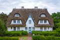 Guesthouse with holiday apartments thatched roof Royalty Free Stock Photo