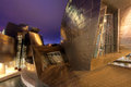 Guggenheim museum bilbao spain december detail of under a dramatic sunset sky on december is Royalty Free Stock Image