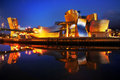 Guggenheim museum in bilbao spain at night july on july the is a dedicated exhibition of modern art and was Stock Photography