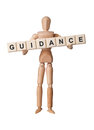 Guidance wooden figurine with the word isolated on white background Royalty Free Stock Photography