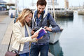 Guide book tourism tourist couple with on vacation Stock Photo