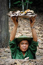 Guide demonstrates Vietcong tunnels Royalty Free Stock Image