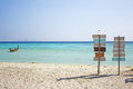 Guidepost on the beach direct you to place island which peaceful Royalty Free Stock Photo