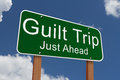 Guilt trip just ahead sign green highway with words with sky background Stock Photo