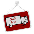 Guilt trip sign a red and white with the words and truck isolated on a white background Stock Images