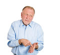 Guilty older man closeup portrait of funny looking guy senior mature business with finger to hand sign showing feeling sorry for Royalty Free Stock Photos