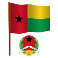 Guinea bissau wavy flag and coat of arms against white background vector art illustration image contains transparency Royalty Free Stock Photos