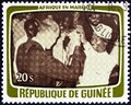 GUINEA - CIRCA 1979: A stamp printed in Guinea shows Toasting the agreement, circa 1979. Royalty Free Stock Photo