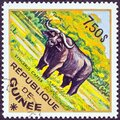 GUINEA - CIRCA 1975: A stamp printed in Guinea from the `Wild Animals` issue shows a Black Rhinoceros Diceros bicornis Royalty Free Stock Photo