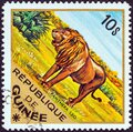 GUINEA - CIRCA 1975: A stamp printed in Guinea from the `Wild Animals` issue shows a Lion Panthera leo, circa 1975. Royalty Free Stock Photo