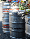 Guinness beer kegs in ireland empty aluminum waiting outside on the street near a pub county clare Stock Image