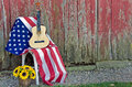 Guitar on American flag Royalty Free Stock Photo