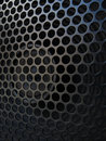 Guitar amplifier speaker with grill detail a metal protective grid good for background Royalty Free Stock Photos
