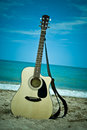 Guitar on the beach Royalty Free Stock Photos