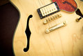 Guitar body detail with sound hole and pickup Royalty Free Stock Photo