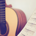 Guitar classic with stand note, retro effect Royalty Free Stock Photo