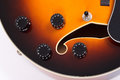 Guitar controls closeup of a sunburst hollow body Royalty Free Stock Photo