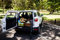 Guitar, fishing rod, picnic basket in car trunk Royalty Free Stock Photo