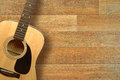 Guitar on floor close up of an acoustic a wooden shot from above Royalty Free Stock Photos