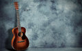 Guitar on grunge wall background Royalty Free Stock Photo
