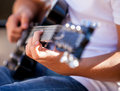 Guitar in the hands of the man Royalty Free Stock Photo