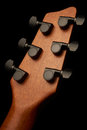 Guitar headstock closeup shot of a with black tuning pegs Royalty Free Stock Photography