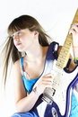 Guitar love young girl strums her electric Stock Photography