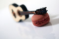 Guitar and macaron on a white background Royalty Free Stock Image