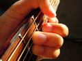 Guitar macro chord a hand close up playing a on an acoustic Stock Photography