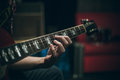 Guitar neck and hand chord selective focus Stock Photo