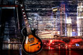 Guitar on night city background Royalty Free Stock Photo
