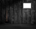 Guitar and old wooden frame on the flap Royalty Free Stock Photo