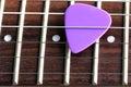 Guitar pick a violet close up shallow dof Royalty Free Stock Photos