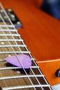 Guitar pick a violet close up shallow dof Stock Photo