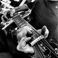 Guitar player black and white picture taken by apple iphone Stock Image