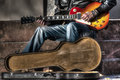 Guitar player with an open guitar case Royalty Free Stock Photo