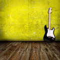 Guitar in the room Royalty Free Stock Image